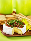 Sliced brie topped with chopped, dried tomatoes