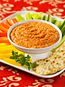 Vegetables crudités and crackers with a pepper and feta cheese dip