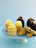 Cupcakes and flapjacks on a cake stand