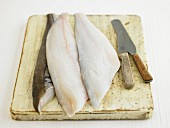 Haddock fillets on a chopping board