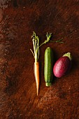 A carrot, a courgette and an aubergine