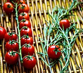 Cherry tomatoes and rosemary on a basket