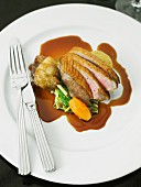 Roast duck with gravy and vegetables