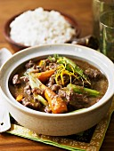 Oriental beef ragout with vegetables and rice
