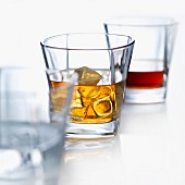 Whiskey on the rocks with ice cubes
