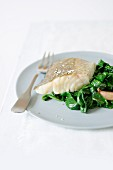 Poached cod with spinach