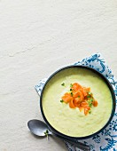 Cream of leek soup garnished with smoked salmon