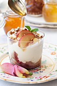 Baked nectarine trifle and caramelised pecan nuts