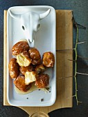 Banana balls with cardamom honey
