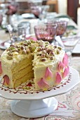 White chocolate cake with pistachio nuts and cardamom