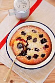 Blackberry clafoutis with icing sugar