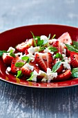 Strawberry salad with goat's cheese, fresh mint and black sesame seeds