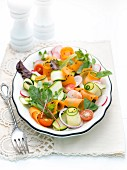 Vegetable salad with courgette strips, carrots and radishes