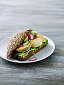 Chicken, radishes and cucumber on a wholemeal roll