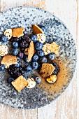 Blueberries with white chocolate cream and liquorice meringue