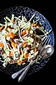 White cabbage salad with mandarins, dates, roasted walnuts and feta