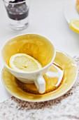 A slice of lemon in a teacup