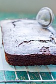 Piece of Midnight Chocolate Sheet Cake with Powdered Sugar