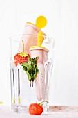 Strawberry ice cream sticks with mint