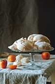 Meringues and apricots on a table