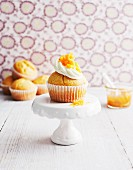 A muffin topped with cream and peach compote