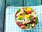 Pasta salad with Serrano ham and tomatoes