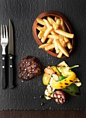 Grilled beef steak with chips and grilled vegetables