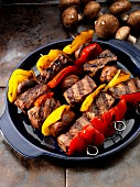 Group skewers with mushrooms and peppers