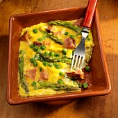 Basque eggs with ham, peas and asparagus with a bite take out