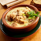 Cream of turkey soup in earthenware bowl with parsley