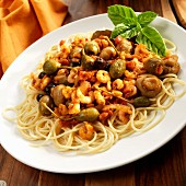 Spaghetti with tiny shrimps, olives, capers, garlic and mushrooms (Sicily)