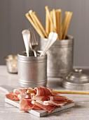 Parma ham with bread sticks for Christmas
