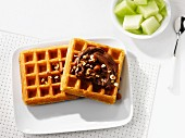 Waffles with chocolate spread and melon