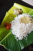 Rice with dahl and chutney on a banana leaf (India)