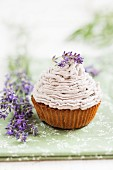 A lavender cupcake topped with buttercream