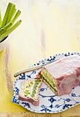 Leek terrine with pistachios and ham