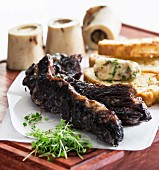 Beef ribs brazen red wine with beef marrow bones and parsley