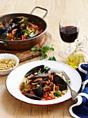 Spaghetti with mussels, tomatoes and chilli