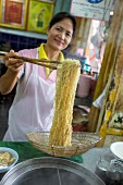 A woman cooking and noodles, Bangkok