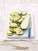 Green and yellow courgettes, halved and sliced