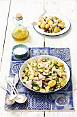 Potato salad with gherkins, raisins and smoked trout