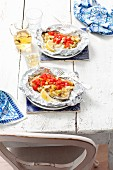 Trout fillets in foil with apples, tomatoes and leak