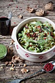 Tagliatelle al pesto con pepe rosa e noci (pasta with pesto, pink pepper and nuts, Italy)