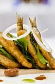 Sarde alla triestina (sardine sandwich with lettuce leaves, Italy)