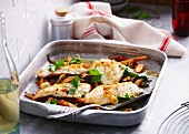Roast snapper in a baking dish garnished with parsley