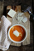 Carrot and ginger soup with grated cheese