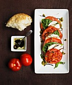 Mozzarella with tomatoes and basil served with a balsamic vinegar dressing and bread