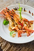 Whole king prawns with chilli peppers on a plate