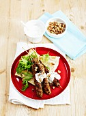 Grilled minced meat skewers with garlic sauce