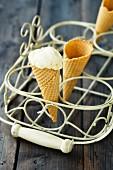Vanilla ice cream cones in a cone holder